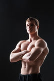 Muscular young man  shows the different movements Stock Photos