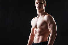 Muscular young man  shows the different movements Royalty Free Stock Photo