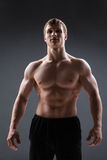 Muscular young man  shows the different movements Stock Images