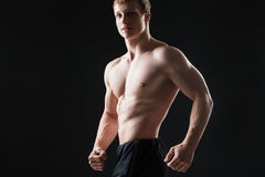 Muscular young man  shows the different movements Stock Photo
