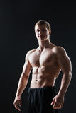 Muscular young man  shows the different movements Stock Image