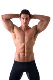 Muscular young man standing and looking at camera smiling royalty free stock photos