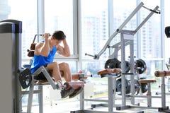Muscular young man training Stock Photos