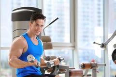Muscular young man training Stock Photo
