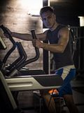 Muscular young man, training pecs on gym machine. Muscular young man, training pecs on gym cable machine stock photography
