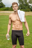 Muscular young man with a water bottle Royalty Free Stock Photos
