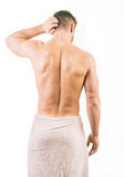 Muscular young man wearing a towel Royalty Free Stock Image