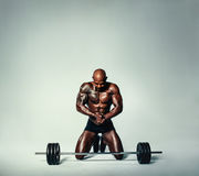 Muscular young man working out with heavy weights Stock Photo