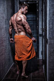 Muscular young sexy guy wrapped in a towel Royalty Free Stock Images
