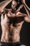 The Muscular Young Sexy Naked Cute Man. Picture with high contrast effect Royalty Free Stock Images