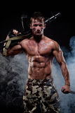 Muscular young sexy naked soldiers with knife Royalty Free Stock Photo