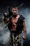 Muscular young sexy naked soldiers with weapons Stock Photography