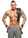 Muscular young sportsman. With weight lifting belt stock images