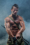 Muscular young wet sexy naked soldiers Royalty Free Stock Image