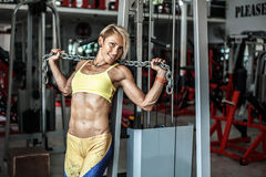 Muscular young woman athlete posing at gym with chain in hands Stock Photo