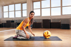 Muscular young woman exercising at gym with kettlebell Stock Photography