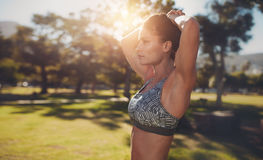 Muscular young woman exercising at the park Royalty Free Stock Image