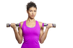 Muscular young woman exercising in sports outfit Royalty Free Stock Photos