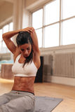 Muscular young woman stretching arms Stock Image