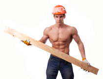 Muscular young worker. In an orange helmet with the board on a white background Stock Photo