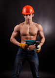 Muscular young worker Royalty Free Stock Images