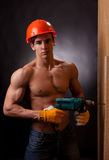 Muscular young worker Stock Image