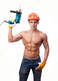 Muscular young worker. In an orange helmet with an electric drill on a white background Royalty Free Stock Image