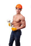 Muscular young worker. In an orange helmet and a wrench on a white background Stock Images