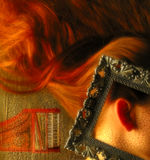 Muse. Long red hair with piano Royalty Free Stock Image