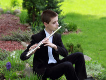 Muse. Teenager with inspiration playing a flute outdoors Royalty Free Stock Photography