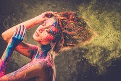 Muse with creative body art. Young woman muse with creative body art and hairdo Royalty Free Stock Images