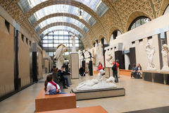 Musee d'Orsay. Apr. 18 2015 Tourists stroll at the Orsay Museum (Musee d'Orsay) - Paris The museum building was originally a railway station, Gare d'Orsay Royalty Free Stock Photo