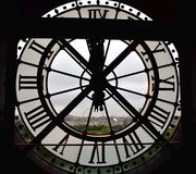 Big window clock at the Orsay Museum Musee d Orsay with Tuileries Garden and big wheel view. Paris, France, 9 Aug 2018. stock photos