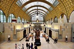 The Musee d'Orsay in Paris, France. PARIS, FRANCE -Visitors at the Musee d'Orsay in Paris. Located in the former Gare d Orsay train station, the museum has the Royalty Free Stock Photos