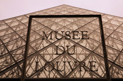 Musee Du Louvre , Paris France. Sign at the Louvre museum pyramid in Paris Stock Photos