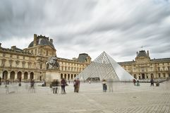 Musee du Louvre. Paris, France - September 10, 2017: Tourists walk in courtyard of the Musee du Louvre Royalty Free Stock Photography