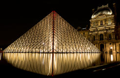Musee Louvre in Paris by night. France Stock Images