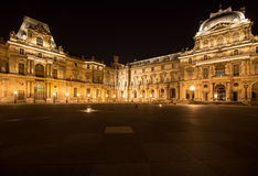 Musee Louvre in Paris by night. France Stock Image