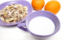 Museli, milk and oranges Royalty Free Stock Photography