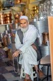Muselman återförsäljaren med pärlor Arkivfoto