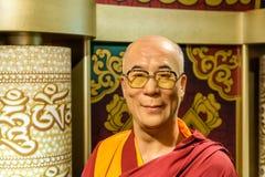 Museo de la cera de Dalai Lama Figurine At Madame Tussauds Foto de archivo libre de regalías