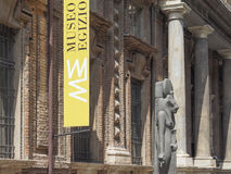 Museo Egizio (Egyptian Museum) in Turin. TURIN, ITALY - CIRCA JULY 2017: Museo Egizio (meaning Egyptian Museum) facade with replica statues of Goddess Sekhmet Royalty Free Stock Images