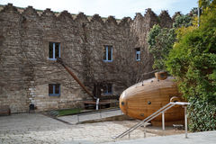 Museu Maritim Barcelona. Yard of Museu Maritim Barcelona with wooden submarine royalty free stock photos