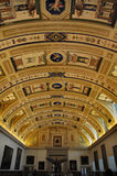 Museum. Art gallery with ancient oil paintings and decorated ceiling Stock Image