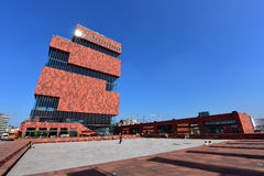 Museum aan de Stroom (MAS) located along river Scheldt is a 60m tall building designed by Neutelings Riedijk Architects Stock Photos