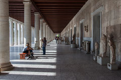 Museum at Ancient Agora Athens Greece. The long hall at the entrance of the Museum with its sculptures, tourists and its colonnade Royalty Free Stock Photos