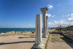 Greek columns of the ancient city of Hersonissos are on the seas Royalty Free Stock Photography