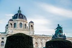 Museum of art history. Vienna, Austria. The dome of the Museum of history art can be seen from behind the bushes, the side of the monument can be seen. Vienna royalty free stock images