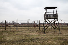 Museum Auschwitz - Birkenau, concentration camp barbed wire and guard tower in Oswiecim city. Museum Auschwitz - Birkenau, concentration camp barbed wire and Royalty Free Stock Image