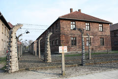Museum Auschwitz - Birkenau. Warning sign high voltage. Barbed wire around a concentration camp. Royalty Free Stock Image